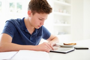 CF teen with tablet