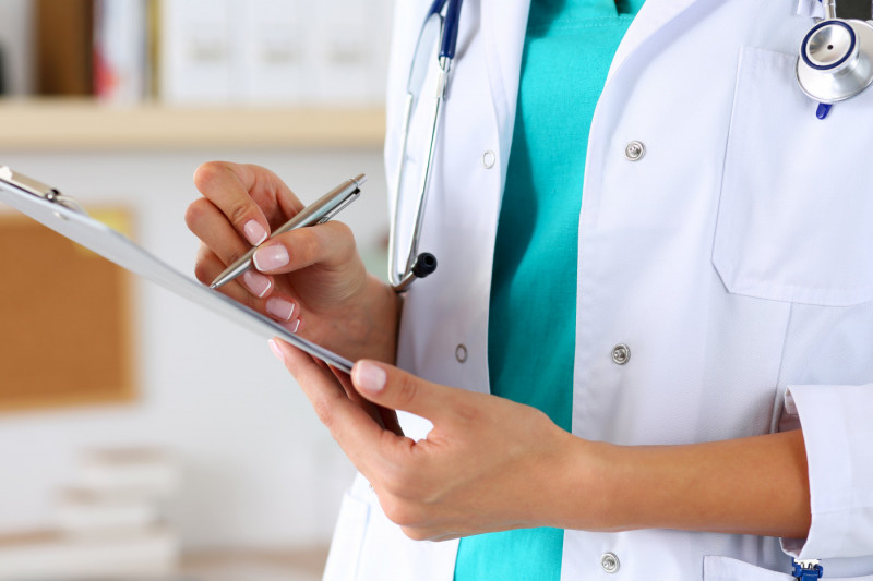 Generic stock image of a doctor holding a clipboard