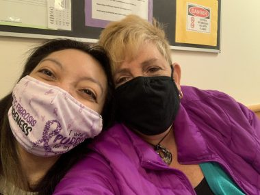 Nicole and her mom wear face masks in the doctor's office.
