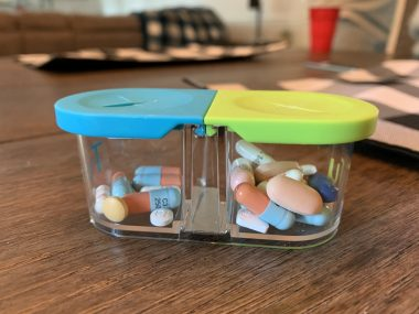 Surviving after lung transplant | Cystic Fibrosis News Today | A small pill container filled with post-transplant medications.