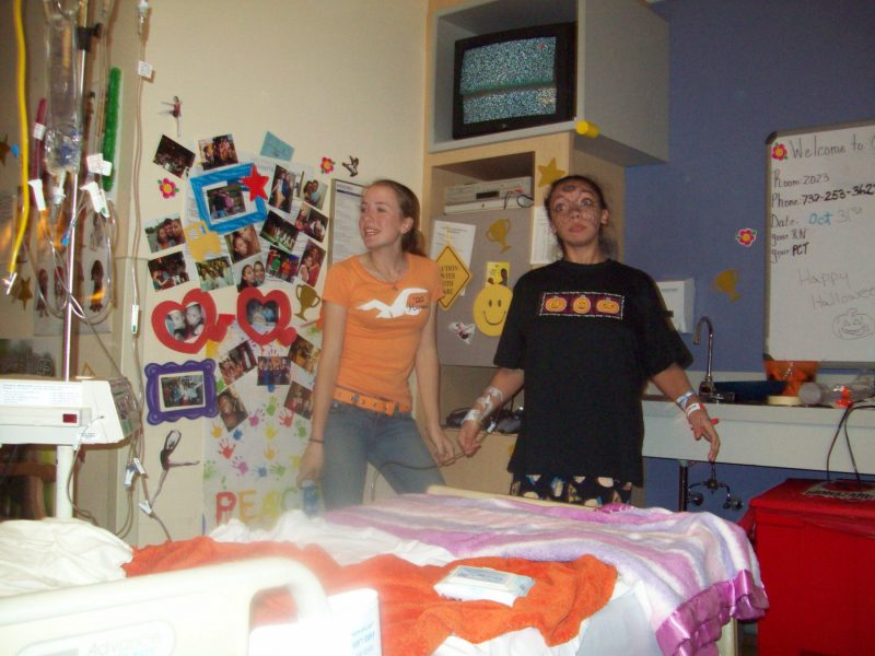 Halloween with a chronic illness | Cystic Fibrosis News Today | Columnist Nicole Kohr poses in her hospital room during Halloween with her friend, Ashley
